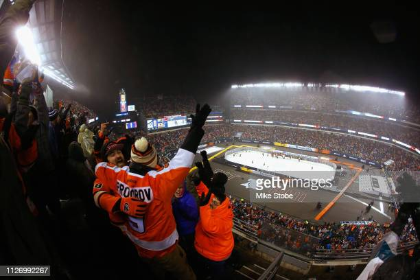 Philadelphia Flyers fans celebrate in the upper seats after the Philadelphia Flyers won in overtime win on a goal by captain Claude Giroux of the...