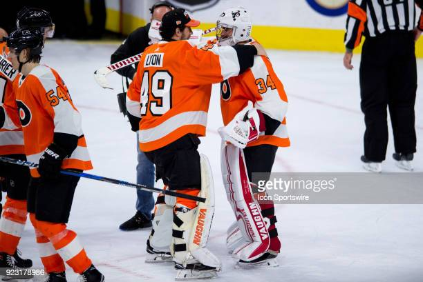 Philadelphia Flyers Goalie Alex Lyon celebrates the win for Philadelphia Flyers Goalie Petr Mrazek after game between the Columbus Blue Jackets and...