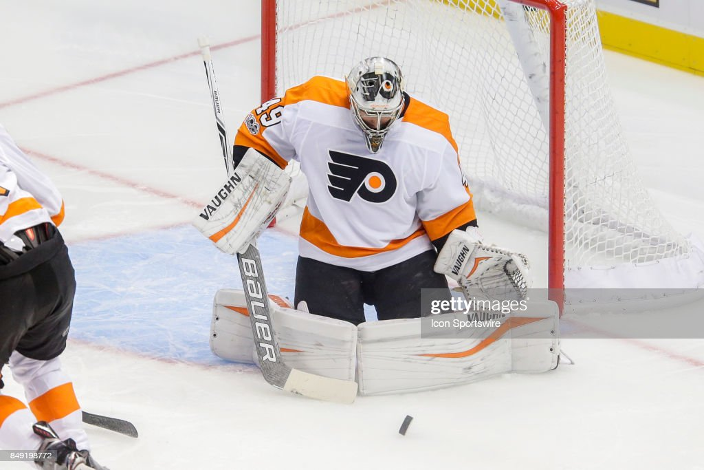 Philadelphia Flyers goalie Alex Lyon (49) makes save during the NHL preseason game between the Philadelphia Flyers and New York Islanders on September 17, 2017, at NYCB Live in Uniondale, NY.