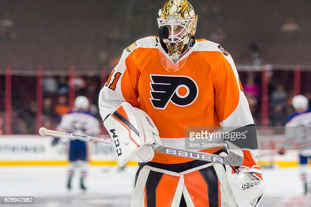 Philadelphia Flyers goalie Anthony Stolarz eyes the puck flying in front of his face during warm ups before the game between the Edmonton Oilers and...
