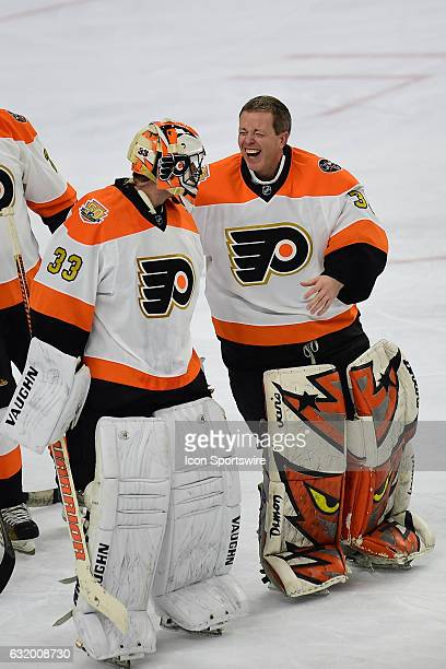 Philadelphia Flyers goalie Brian Boucher and Philadelphia Flyers goalie Neil Little share a laugh during a NHL hockey game between the Philadelphia...
