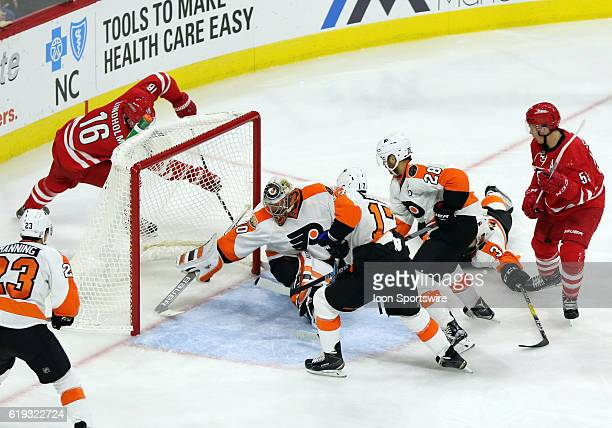 Philadelphia Flyers Goalie Michal Neuvirth reaches behind him to make a save during the 2nd period of the Carolina Hurricanes game verus the...