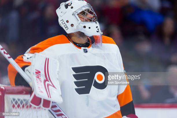 Philadelphia Flyers Goalie Petr Mrazek looks up the clock as there is a stoppage in play during third period National Hockey League action between...