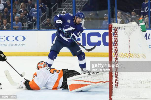 Philadelphia Flyers goaltender Brian Elliott lays out to block the shot from Tampa Bay Lightning left wing Alex Killorn in the second period of the...