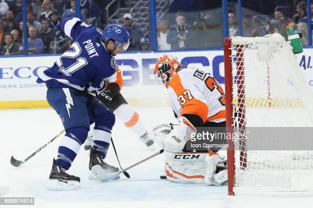 Philadelphia Flyers goaltender Brian Elliott makes a save on a shot from Tampa Bay Lightning center Brayden Point in the second period of the NHL...