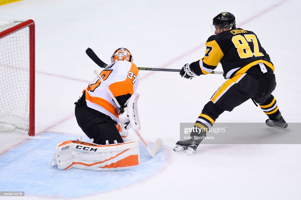 Philadelphia Flyers goaltender Brian Elliott (37) makes a save on Pittsburgh Penguins center Sidney Crosby (87) in front during the second period in Game Two of the Eastern Conference First Round in the 2018 NHL Stanley Cup Playoffs between the Philadelphia Flyers and the Pittsburgh Penguins on April 13, 2018, at PPG Paints Arena in Pittsburgh, PA.