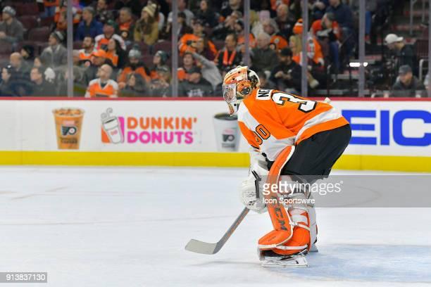 Philadelphia Flyers goaltender Michal Neuvirth assumes goaltender duties as overtime begins during the NHL game between the Ottawa Senators and the...
