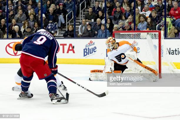 Philadelphia Flyers goaltender Michal Neuvirth deflects a shot from Columbus Blue Jackets left wing Artemi Panarin in the first period of a game...