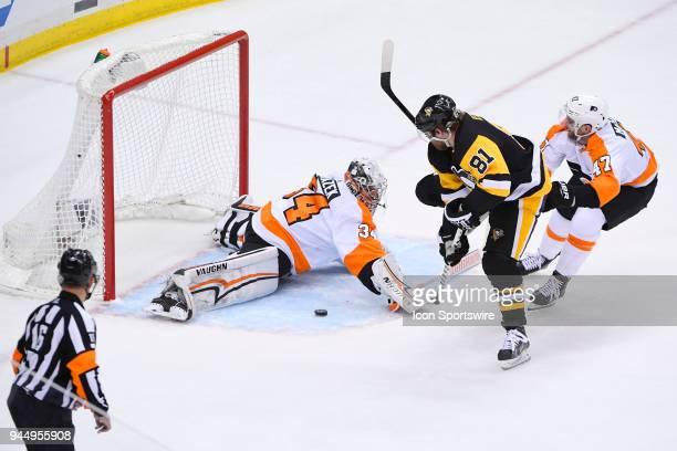 Philadelphia Flyers goaltender Petr Mrazek makes a save on Pittsburgh Penguins right wing Phil Kessel while Philadelphia Flyers defenseman Andrew...