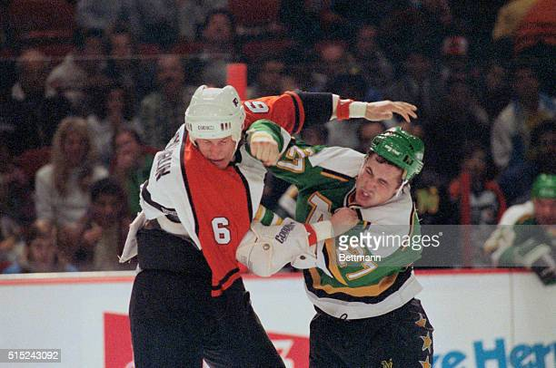 Flyers' Jeff Chychrun and Minnesota's Shane Churla grimaces as they exchange blows during a fight in the first period Philadelphia FlyersMinnesota...