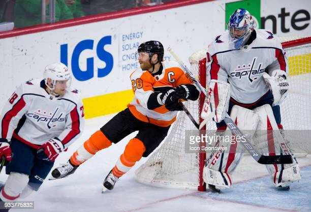 Philadelphia Flyers Left Wing Claude Giroux avoids the stick of Washington Capitals Goalie Philipp Grubauer as he comes around the net in the third...