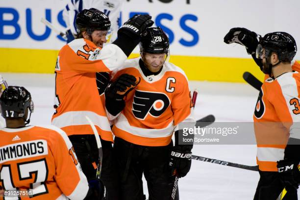 Philadelphia Flyers Left Wing Claude Giroux celebrates with Center Sean Couturier and Defenceman Radko Gudas after a goal in the first period during...