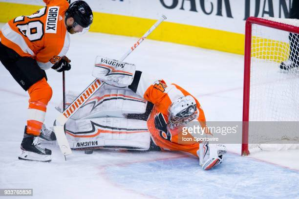Philadelphia Flyers Left Wing Claude Giroux tries to a collect a puck saved by a diving Philadelphia Flyers Goalie Petr Mrazek in the first period...