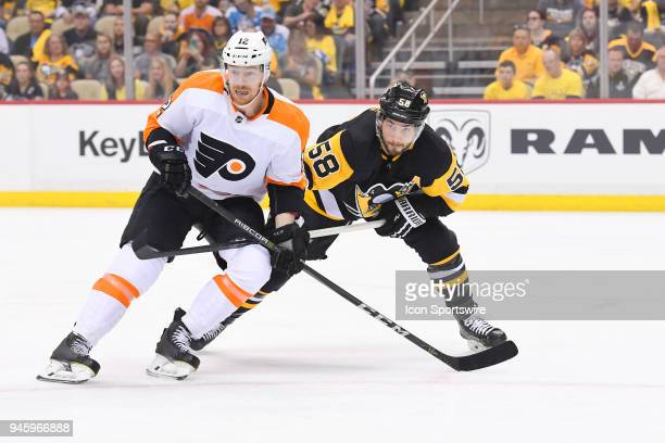 Philadelphia Flyers left wing Michael Raffl and Pittsburgh Penguins defenseman Kris Letang battle for position during the first period in Game Two of...
