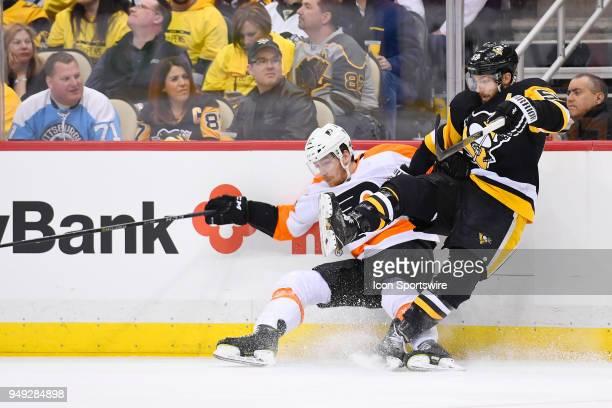 Philadelphia Flyers left wing Michael Raffl and Pittsburgh Penguins defenseman Kris Letang collide during the third period The Philadelphia Flyers...