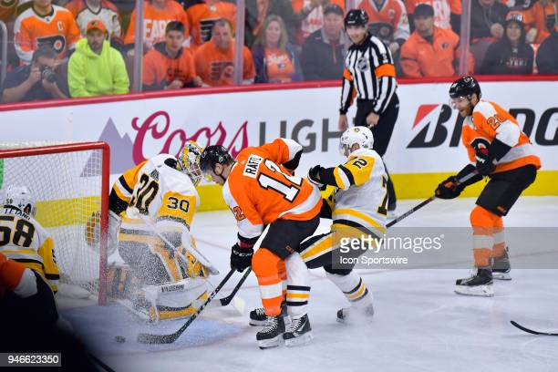 Philadelphia Flyers left wing Michael Raffl tries to get one past Pittsburgh Penguins goaltender Matt Murray during the NHL game between the...