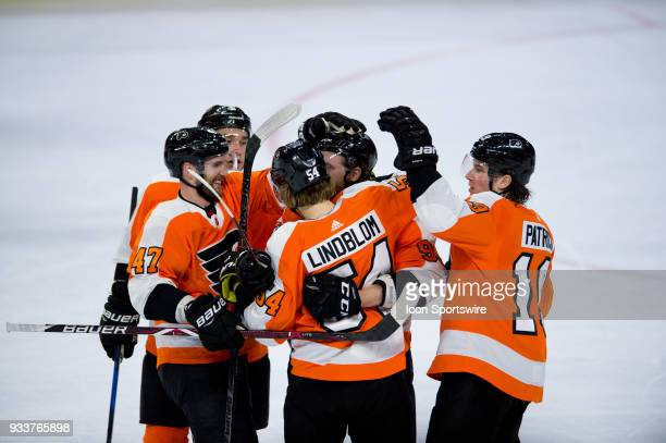 Philadelphia Flyers Left Wing Oskar Lindblom celebrates with Right Wing Jakub Voracek Defenceman Andrew MacDonald Center Nolan Patrick and Defenceman...