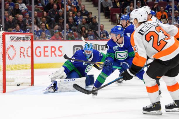 Philadelphia Flyers Left Wing Oskar Lindblom scores a goal on Vancouver Canucks Goaltender Jacob Markstrom during their NHL game at Rogers Arena on...