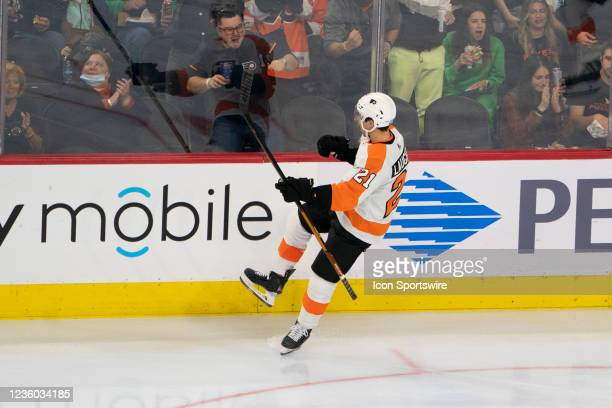 Philadelphia Flyers Left Wing Scott Laughton reacts to scoring a goal during the second period of a National Hockey League game between the Boston...
