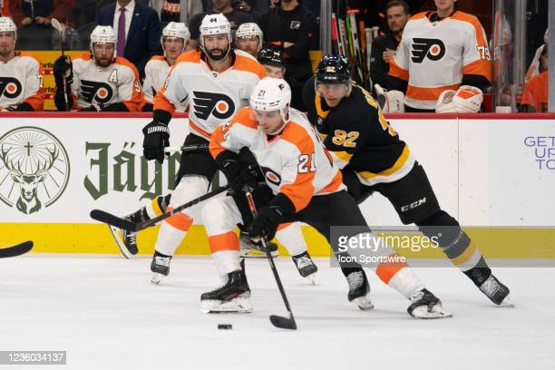 Philadelphia Flyers Left Wing Scott Laughton skates with the puck with Boston Bruins Left Wing Tomas Nosek in pursuit during the third period of a...