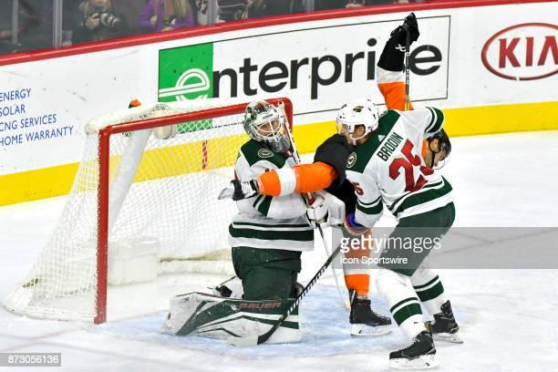 Philadelphia Flyers left wing Taylor Leier balanced on one leg gives interference between Minnesota Wild defenseman Jonas Brodin and Minnesota Wild...