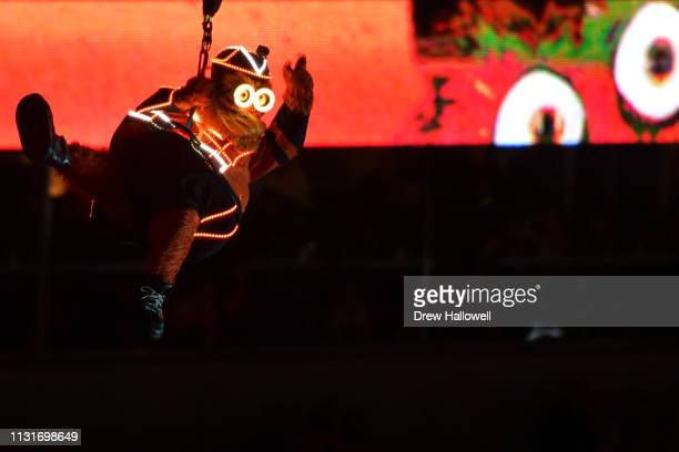 Philadelphia Flyers mascot Gritty drops into the stadium before the game against the Pittsburgh Penguins during the 2019 Coors Light NHL Stadium...