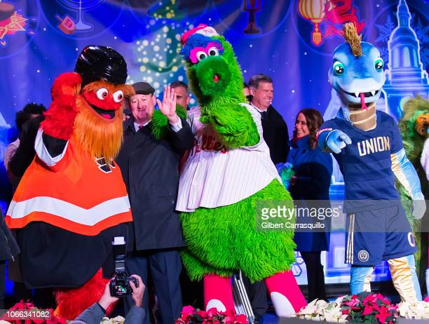 Philadelphia Flyers mascot Gritty The 99th Mayor of Philadelphia Jim Kenney The Phillie Phanatic and Philadelphia Union mascot Phang on stage during...