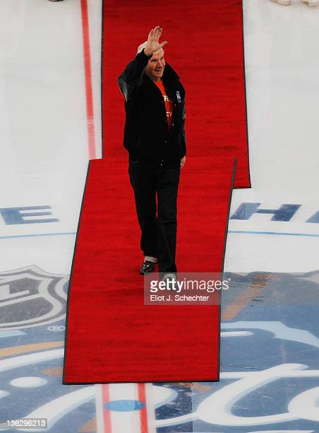 Philadelphia Flyers owner Ed Snider waves to the crowd before the ceremonial puck drop prior to the start of the Alumni Game between the Philadelphia...