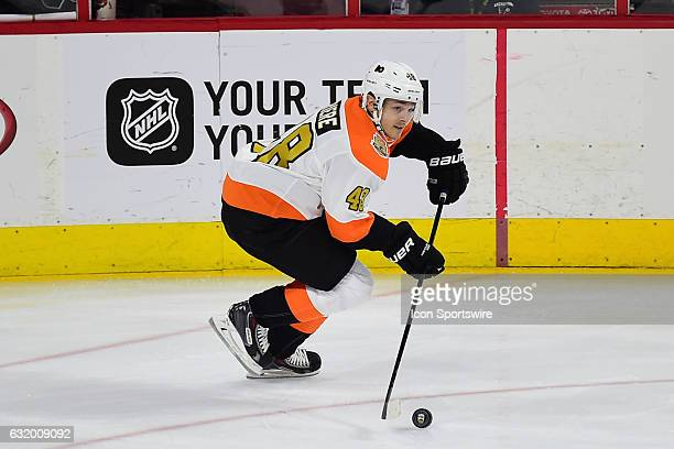 Philadelphia Flyers right wing Danny Briere skates with the puck during a NHL hockey game between the Philadelphia Flyers Alumni and the Pittsburgh...