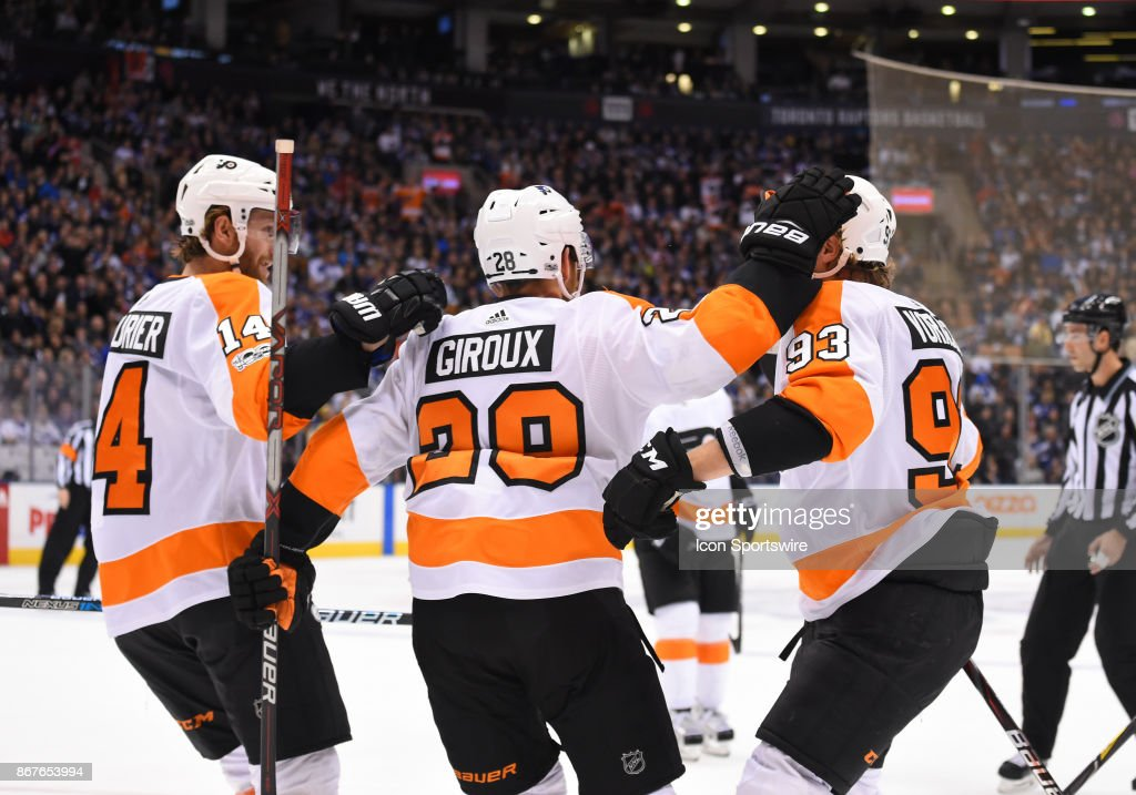 Philadelphia Flyers right wing Jakub Voracek (93) celebrates a goal with Philadelphia Flyers center Sean Couturier (14) and Philadelphia Flyers center Claude Giroux (28) in the first period during a game between the Philadelphia Flyers and the Toronto Maple Leafs on October 28, 2017 at Air Canada Centre in Toronto, Ontario Canada.
