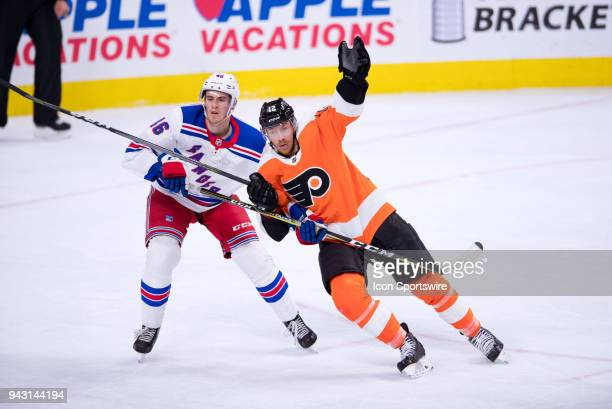 Philadelphia Flyers Right Wing Michael Raffl tries to skate past New York Rangers Defenceman Rob O'Gara in the first period during the game between...