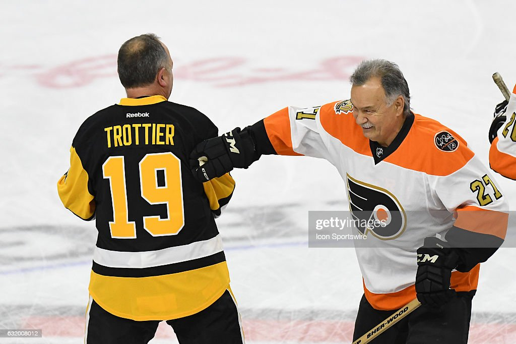 philadelphia flyers right wing reggie leach and pittsburgh penguins