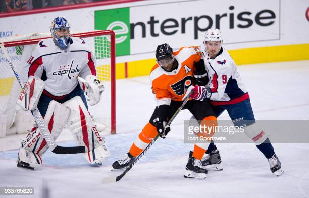 Philadelphia Flyers Right Wing Wayne Simmonds battles with Washington Capitals Defenceman Dmitry Orlov for a spot in front of the net in the first...