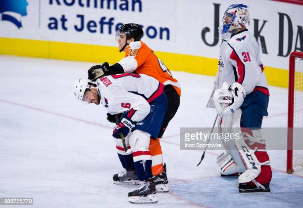 Philadelphia Flyers Winger Jordan Weal pushes Washington Capitals Defenceman Michal Kempny in front of the net in the second period during the game...