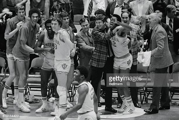 Philadelphia: Indiana's head coach, Bobby Knight hugs Scott May as they are jubliant after defeating Michigan to win the NCAA basketball championship...