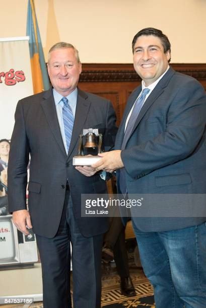 Philadelphia Mayor Jim Kenney poses with Producer Adam F Goldberg during an event honoring Goldberg at Philadelphia City Hall on September 15 2017 in...