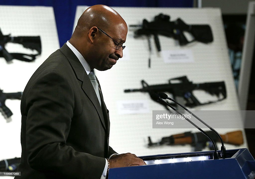 Philadelphia Mayor Michael Nutter pauses as he speaks next to a display of assault weapons during a news conference January 24, 2013 on Capitol Hill in Washington, DC. U.S. Senator Dianne Feinstein (D-CA) announced that she will introduce a bill to ban assault weapons and high-capacity magazines capable of holding more than 10 rounds to help to stop gun violence.
