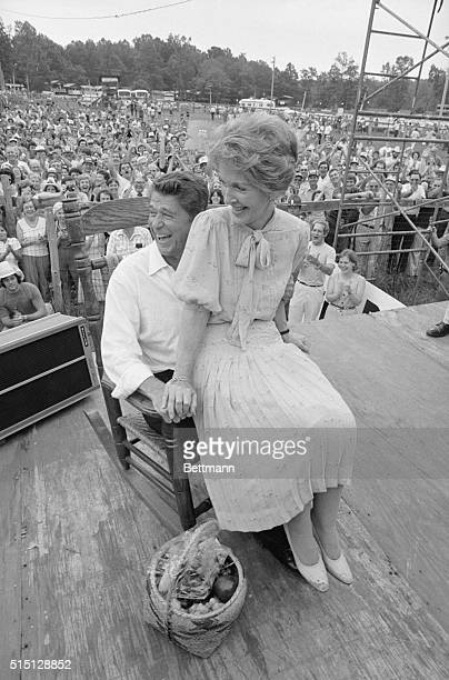 Philadelphia, Miss: Republican presidential nominee Ronald Reagan and wife, Nancy, share a chuckle as they try rocking chair presented them during...