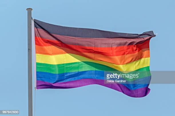 philadelphia new 8 stripes black & brown gay pride flag - lgbtqi pride event stock pictures, royalty-free photos & images
