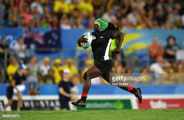 Philadelphia Olando of Kenya breaks through to score a try during the Rugby Sevens Women's Pool A match between Canada and Kenya on day nine of the...