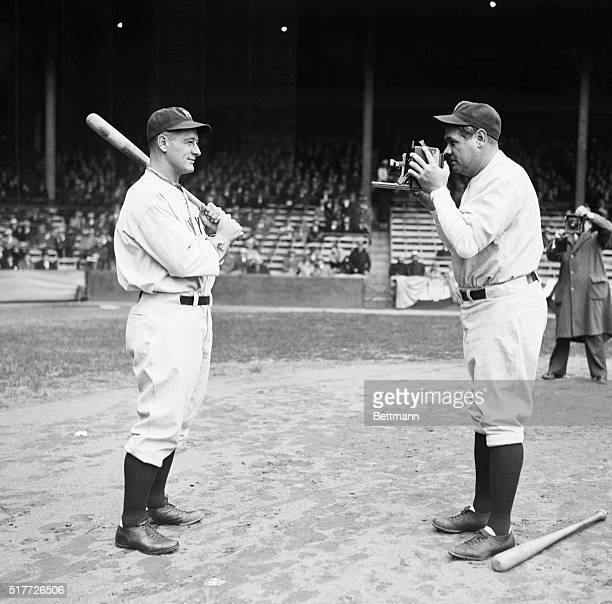 Philadelphia, PA: Babe Ruth takes a picture of Lou Gehrig before the start of the opening game of the 1932 baseball season between the New York...
