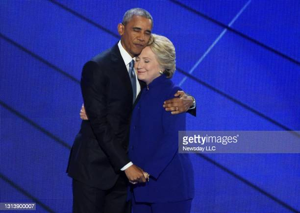President Barack Obama and Hillary Clinton embrace on the stage after the speech by Obama at the Democratic National Convention at the Wells Fargo...