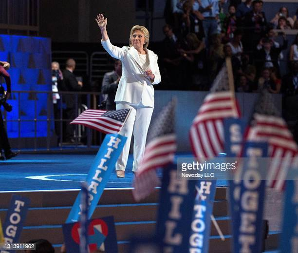 Presidential candidate Hillary Clinton waves to the crowd from the stage at the Democratic National Convention at the Wells Fargo Center in...