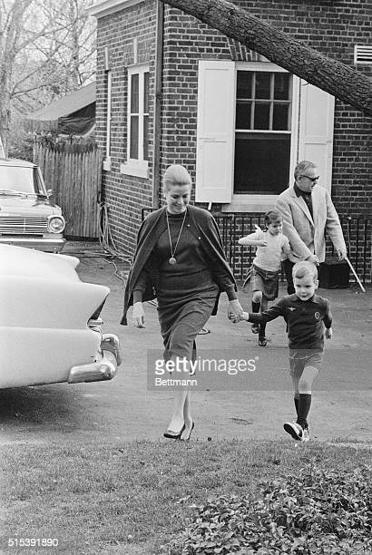 Princess Grace of Monaco has a tight grip on the hand of her son Prince Albert as Prince Rainier tries to keep up with daughter Princess Caroline as...