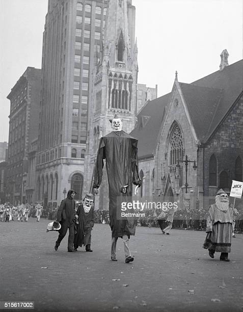 """Philadelphia, PA: The """"Giant Men"""" parading in the Thanksgiving Day Parade held annually by the Gimbel Brothers Store. INP photo."""