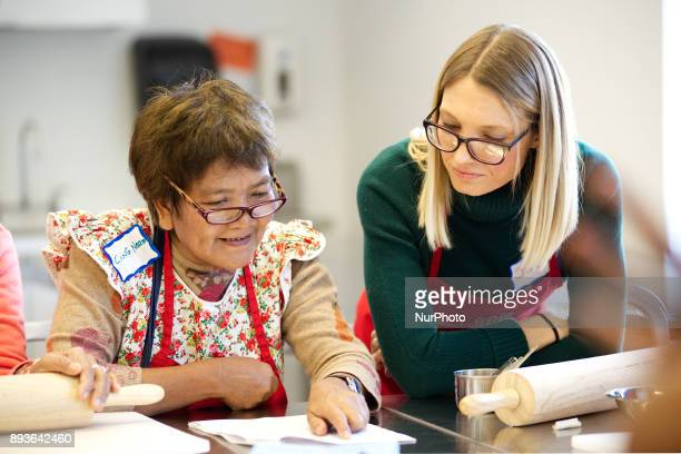 Philadelphia PA USA January 6 2016 Adult student and immigrant Cing Neam goes over a recipe in the English language with ESL instructor Jillian...