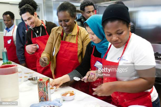 Philadelphia PA USA January 6 2016 Adult students and immigrants prepare food during an EnglishasaSecondLanguage course geared to recent immigrants A...