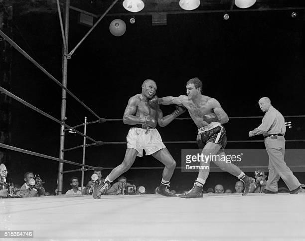 Philadelphia Pennsylvania Joe Walcott's face is a misshapen mass under the force of a blow from Rocky Marciano Rocky was losing on points when he...