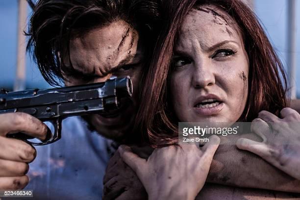 USA, Philadelphia, Pennsylvania, Movie-themed image showing man holding pistol next to woman's head