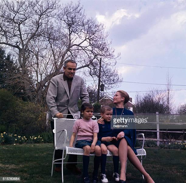 Philadelphia Pennsylvania Princess Grace and Prince Rainier of Monaco pose with their children Princess Caroline and Prince Albert in the garden of...